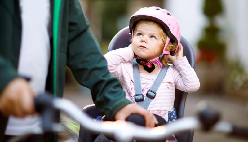 Сute baby riding a bike